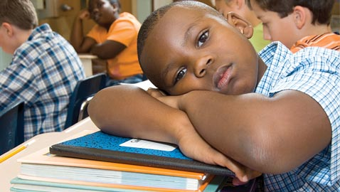 black-boy-with-head-on-desk