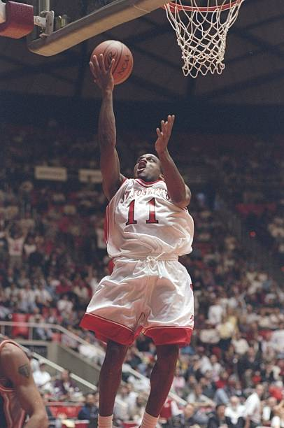 mar-1997-guard-rashid-bey-of-the-st-josephs-hawks-drives-to-basket-a-picture-id298508